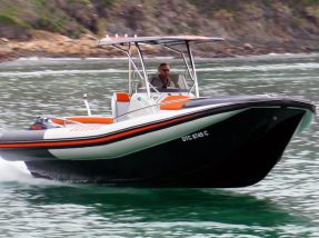 Man Operating RIB Boat - RIB Boat - Hysucat